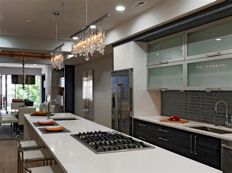 Modern Kitchen With Long Island and Crystal Track Lights