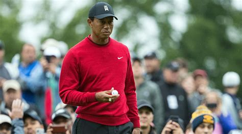 Tiger's red sweater at BMW evokes iconic outfit from his